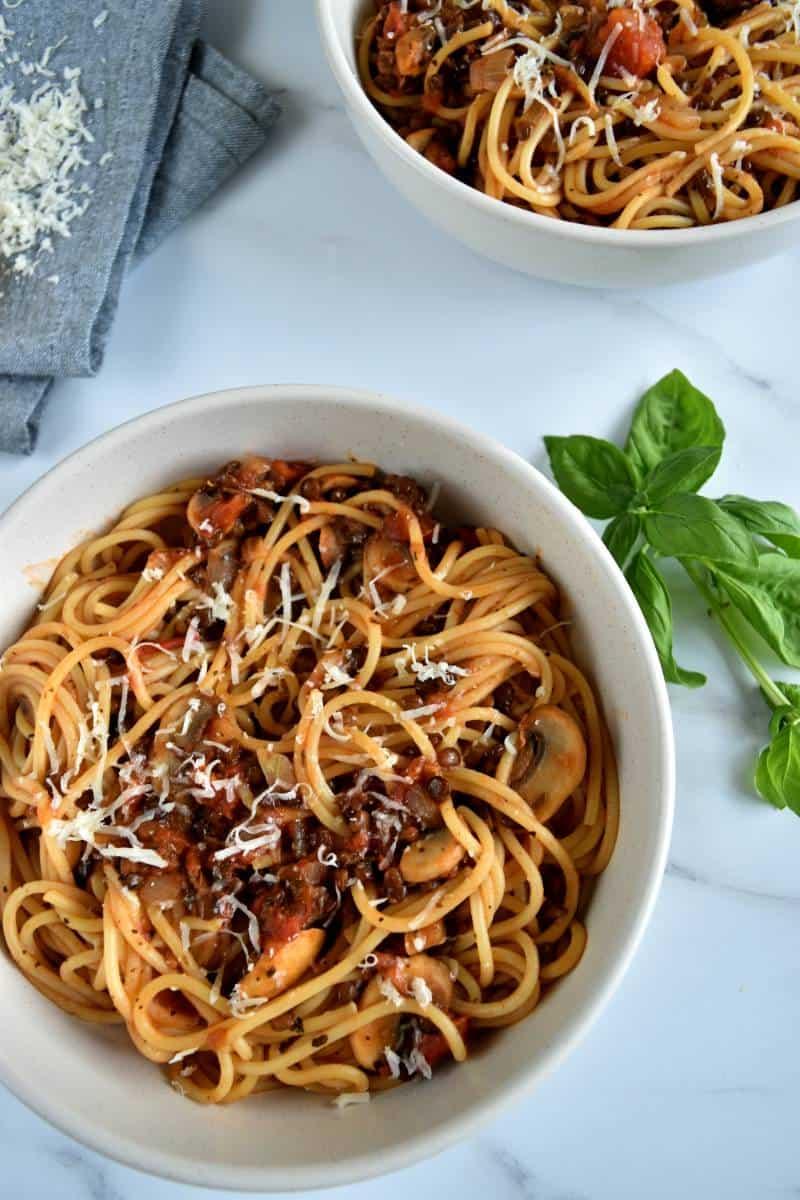 Lentil and mushroom bolognese in pasta bowls.