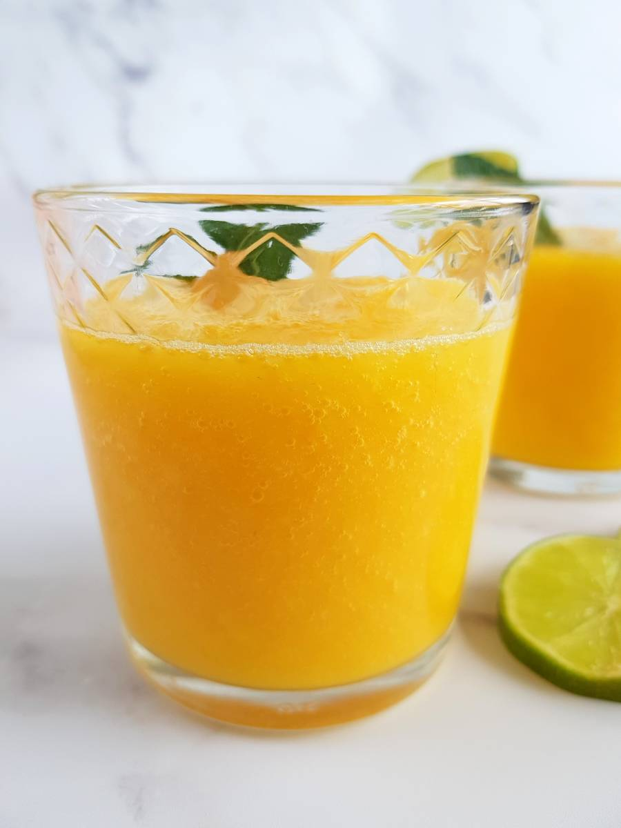 Mexican mango drink on a marble table.