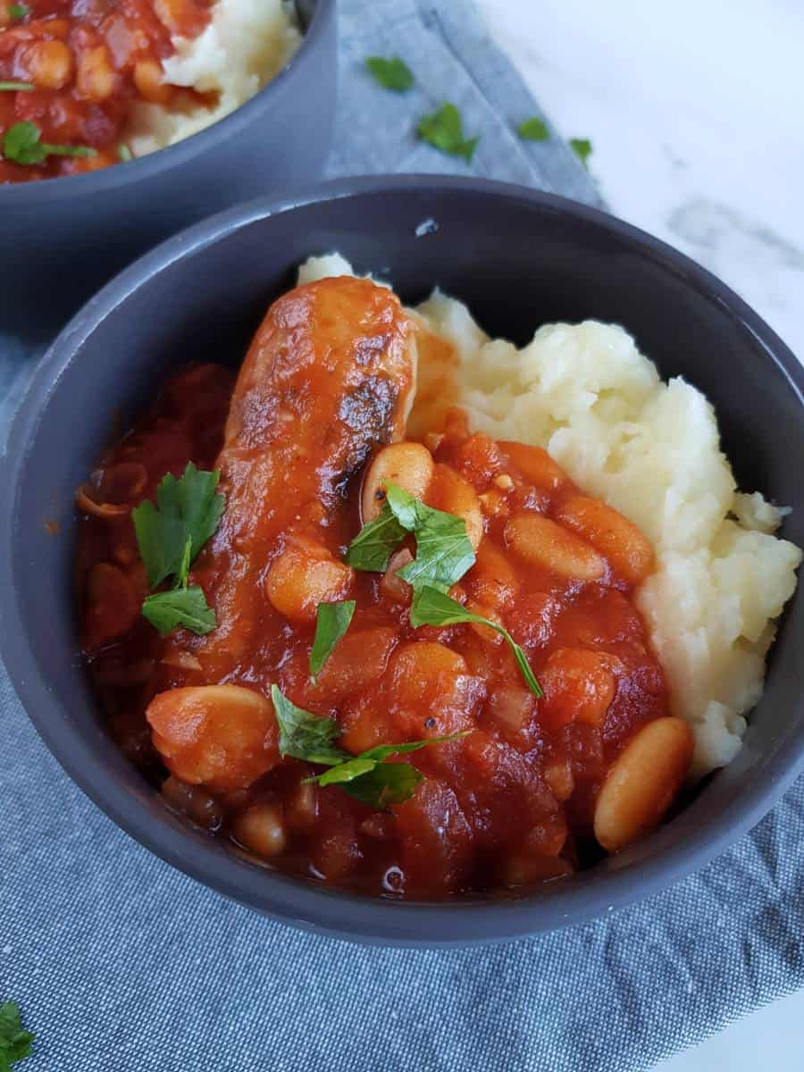 Sausage stew with cannellini beans with mashed potatoes.
