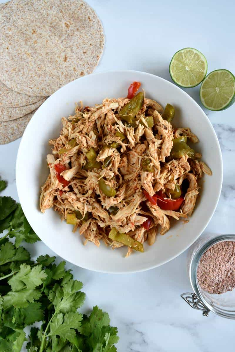 Slow cooker chicken fajitas in a bowl.