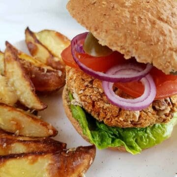 Vegan pinto bean burgers with wedges.