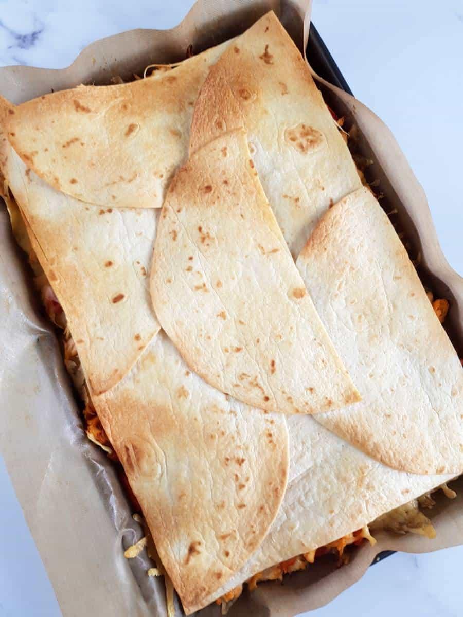 sheet pan buffalo chicken quesadillas.