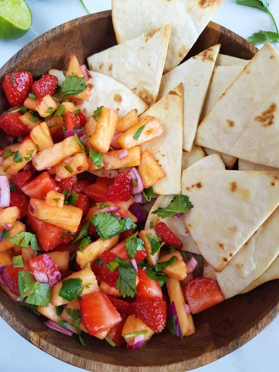 Pineapple strawberry salsa with tortilla chips.