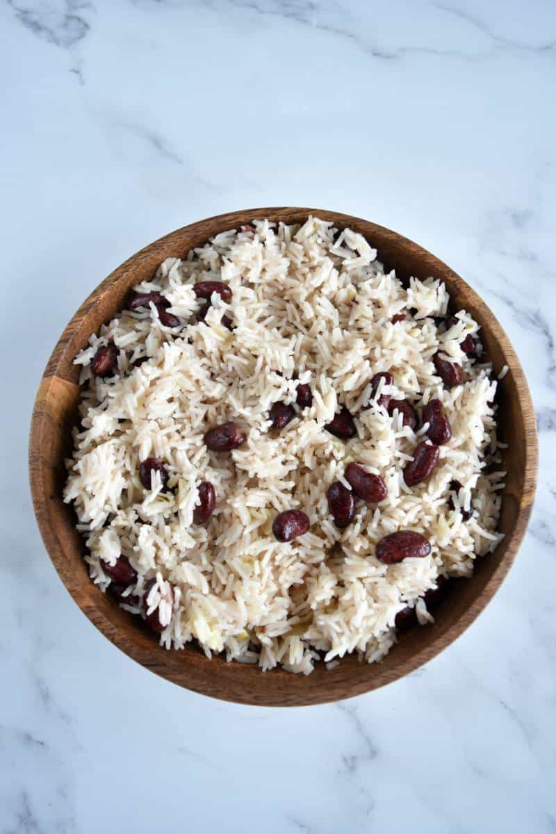 Red beans and coconut rice in a wooden bowl.