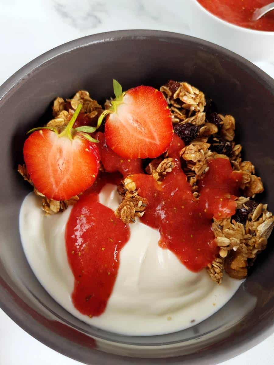 Strawberry sauce on granola.