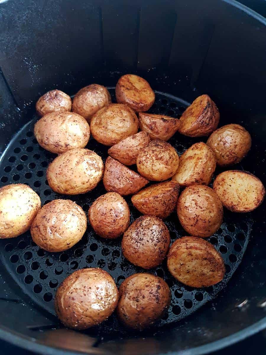 Potatoes in an air fryer.
