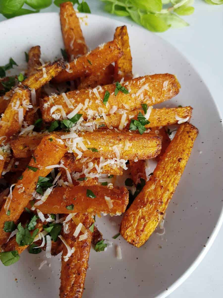 Air fryer roasted carrots on a plate.