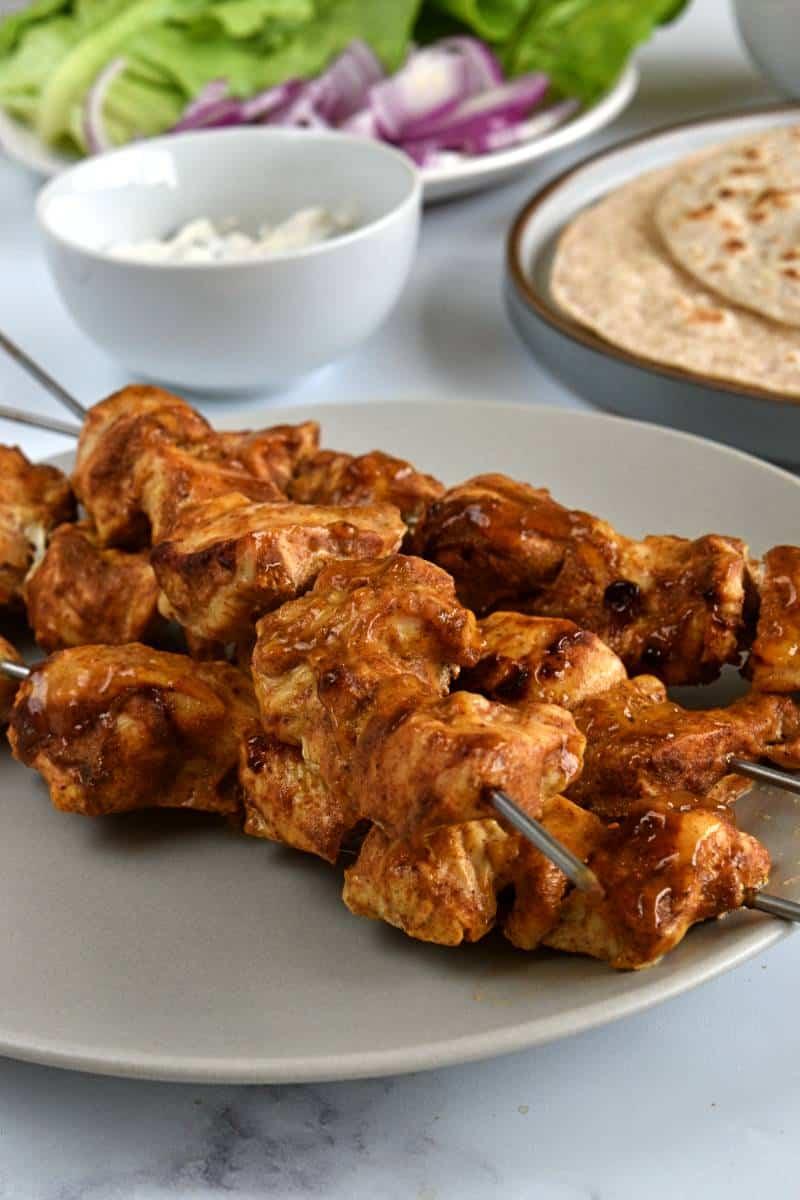 Chicken kebabs with tikka on skewers.
