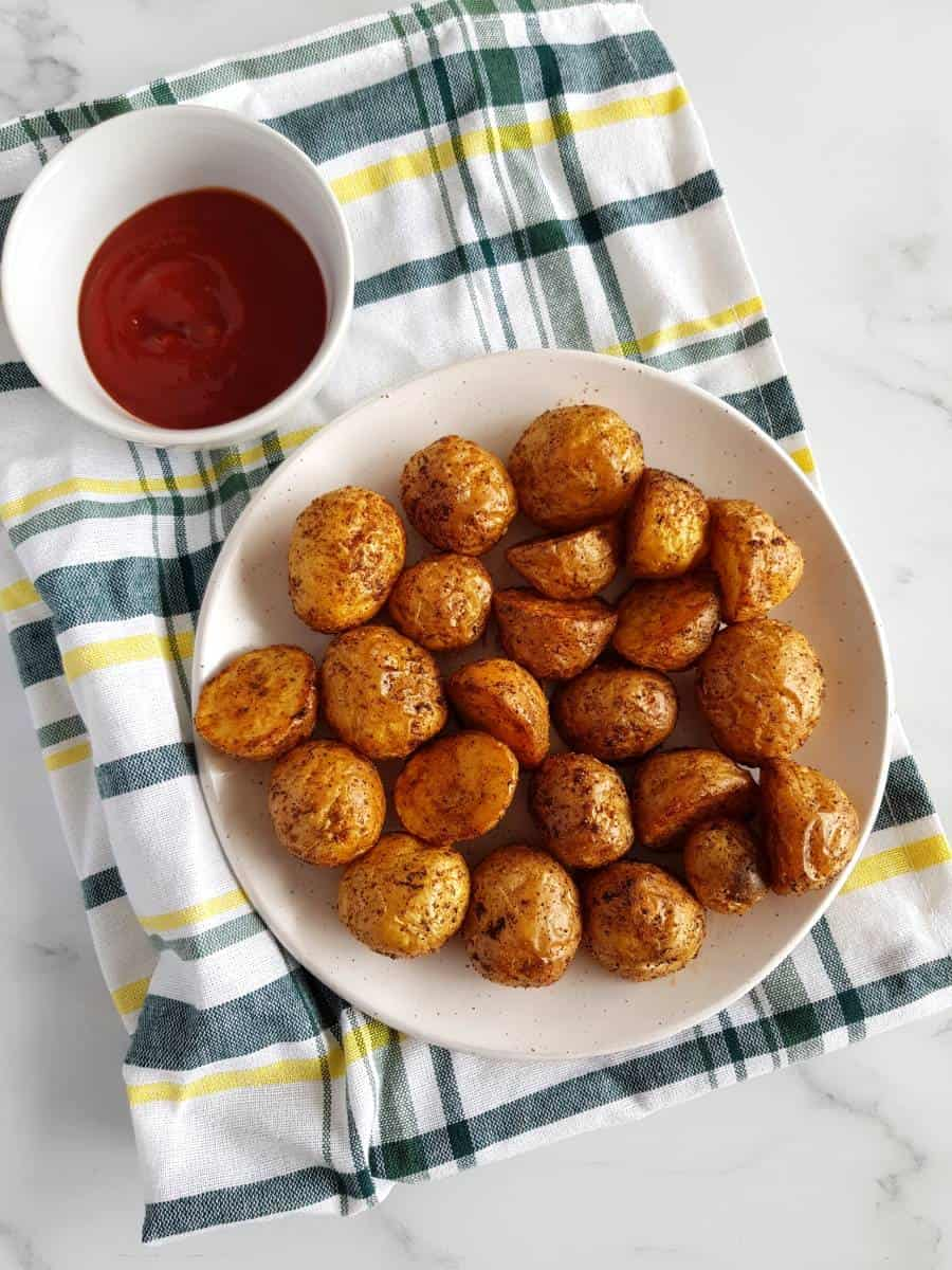 Crispy air fried potatoes with ketchup.