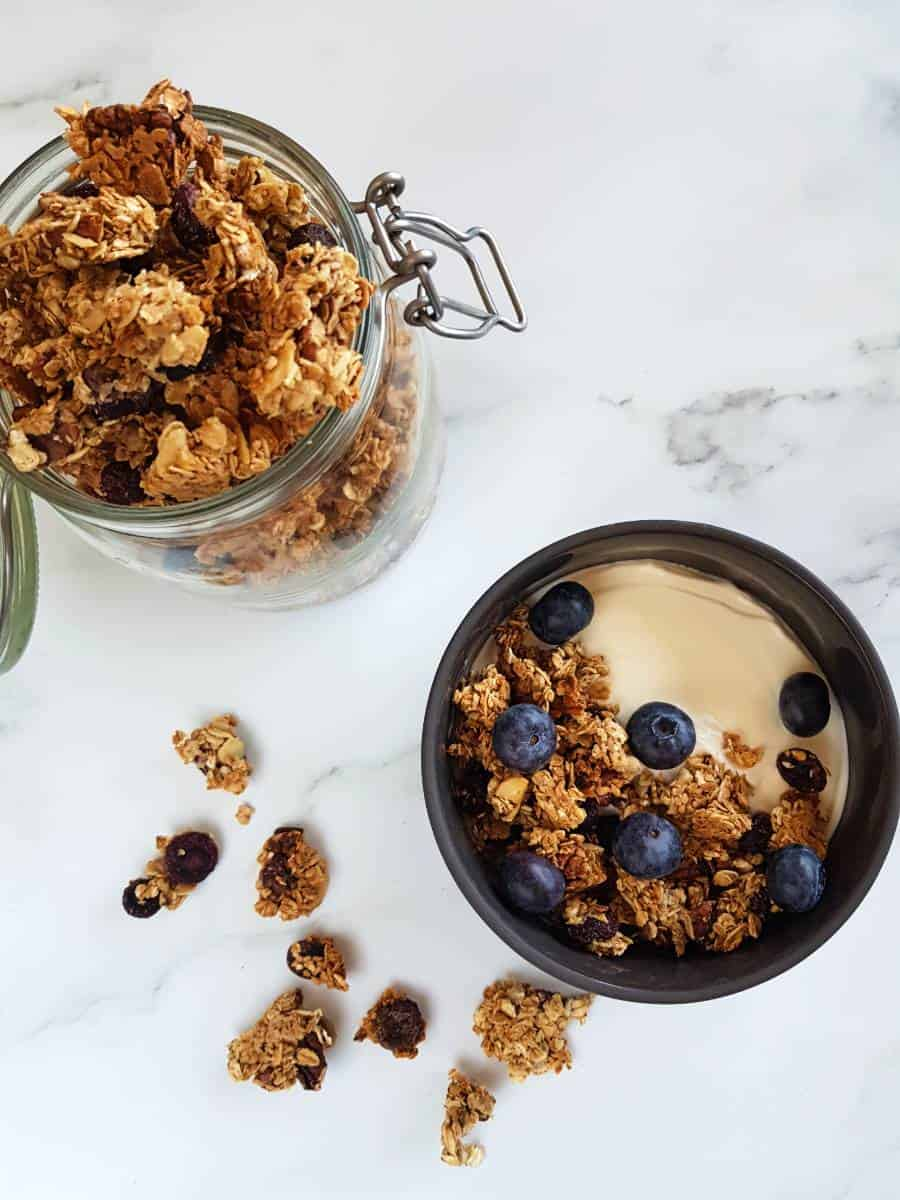 Homemade granola with blueberries in a bowl with yogurt.