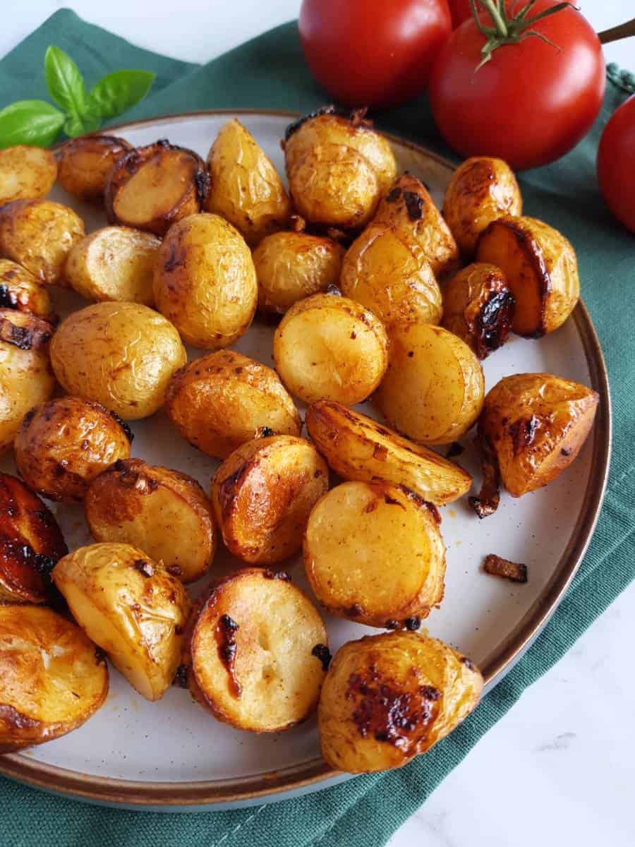 Honey glazed potatoes on a plate.