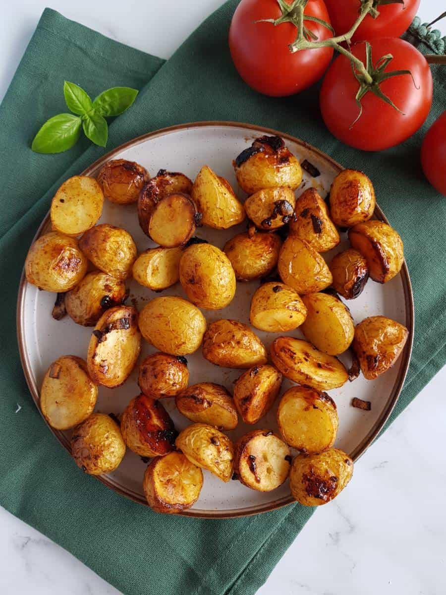 Honey roasted potatoes on a plate.