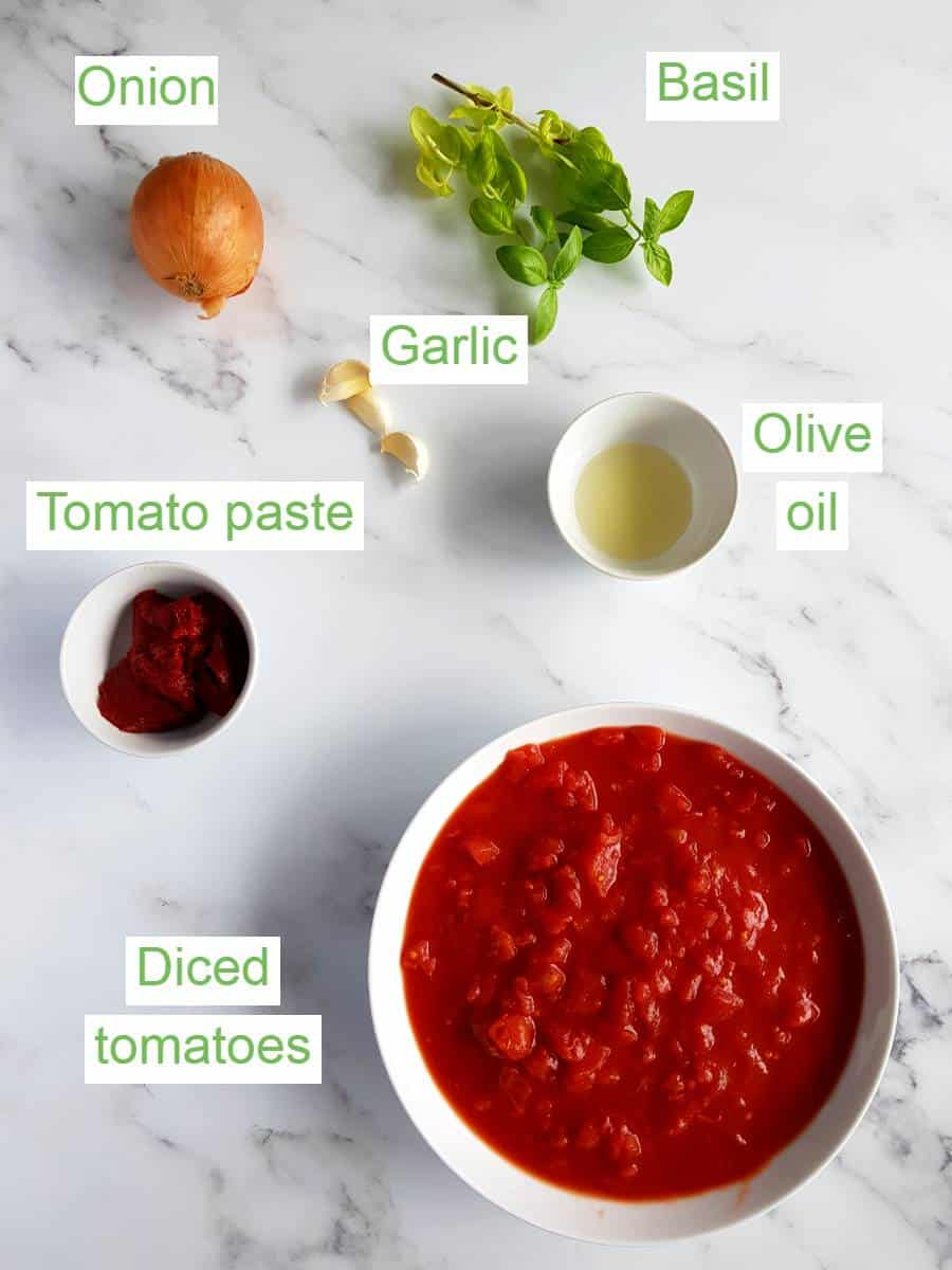 Spaghetti sauce ingredients on a table.