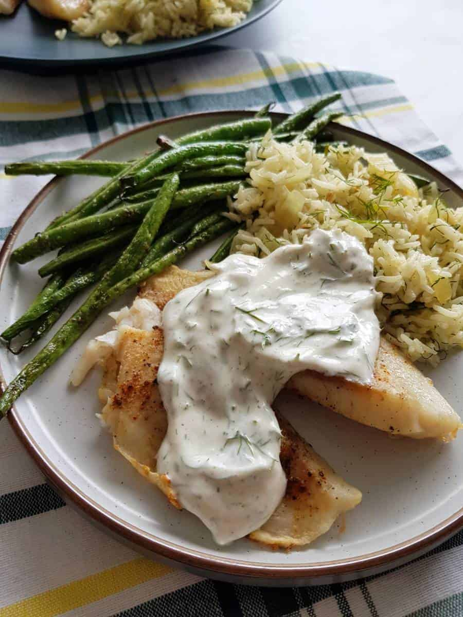 Tilapia with yogurt dill sauce.