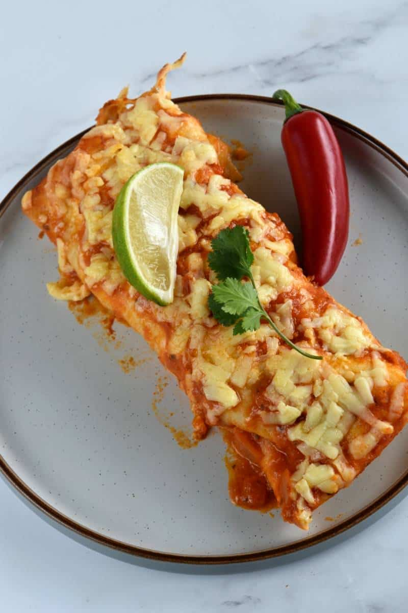 Turkey enchiladas on a plate.