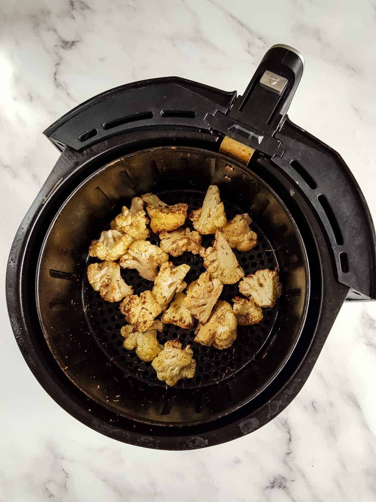 Roasted cauliflower in an air fryer.