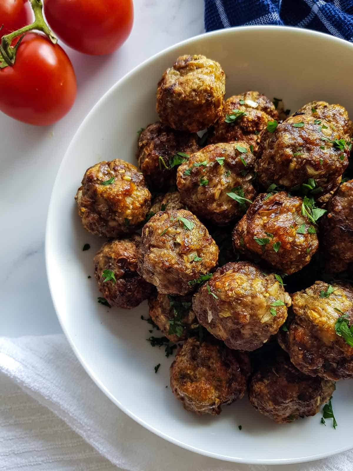 Meatballs with parsley on top.
