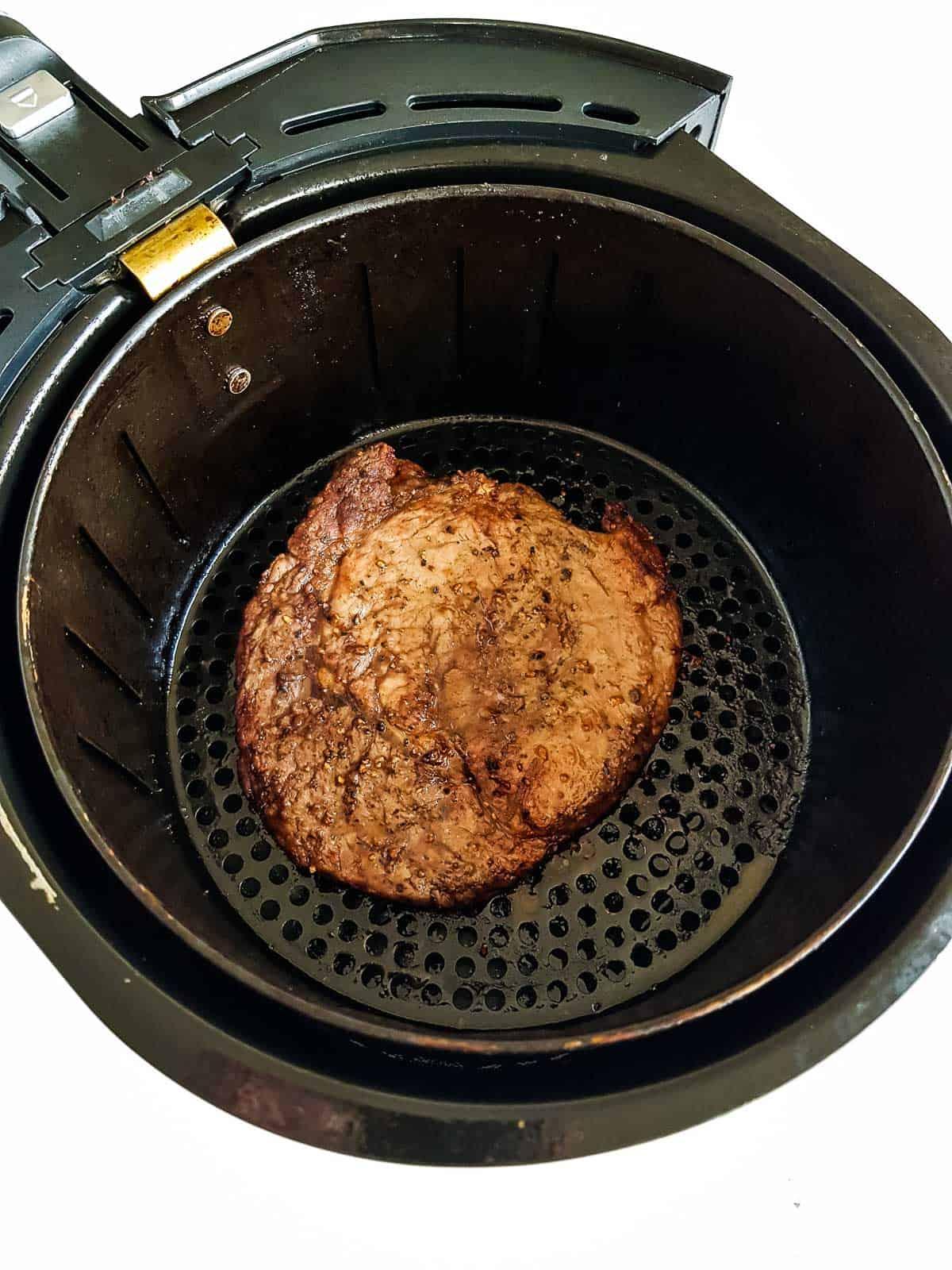 Steak in an air fryer.