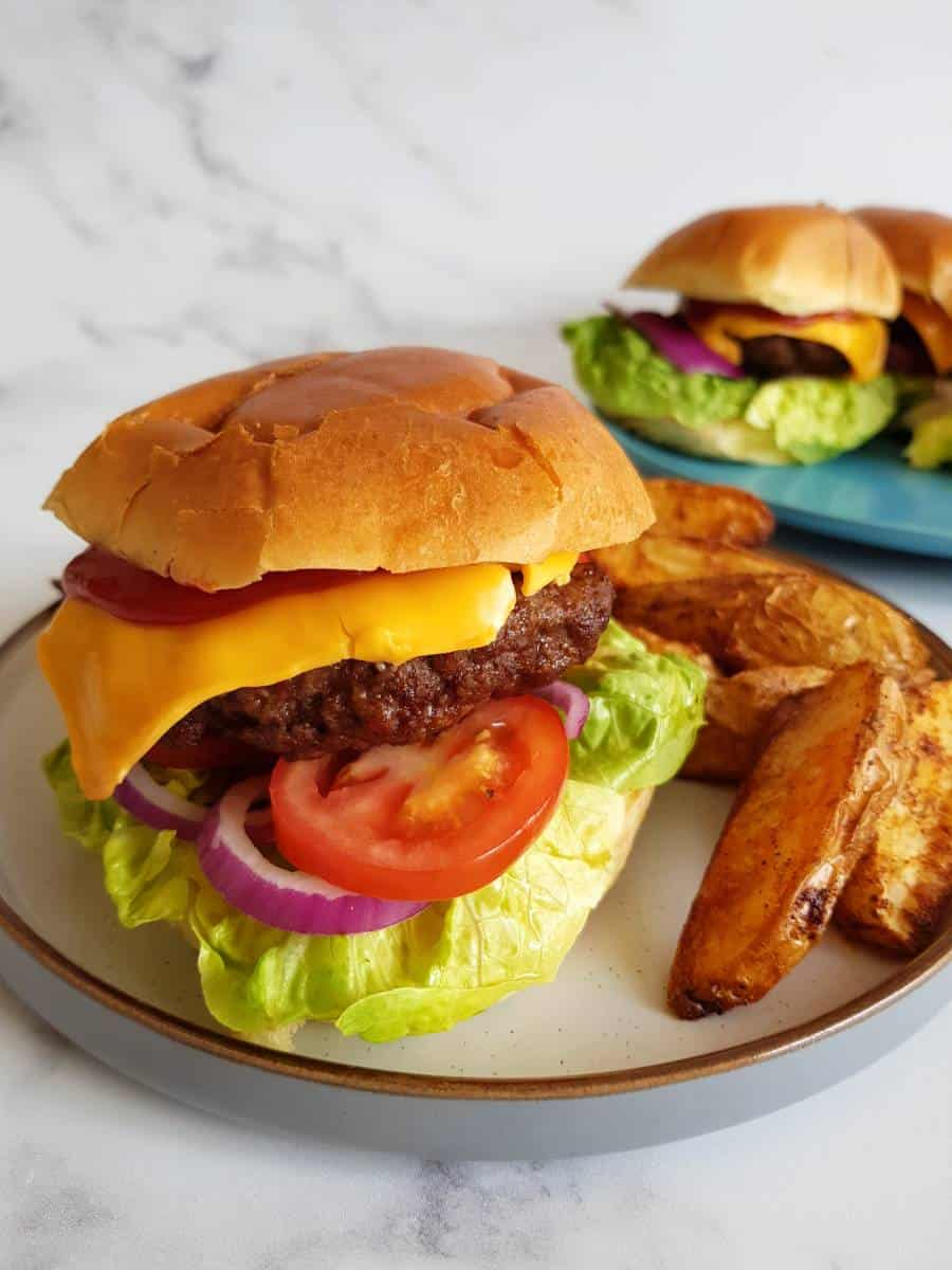 Air fryer hamburgers with potato wedges.
