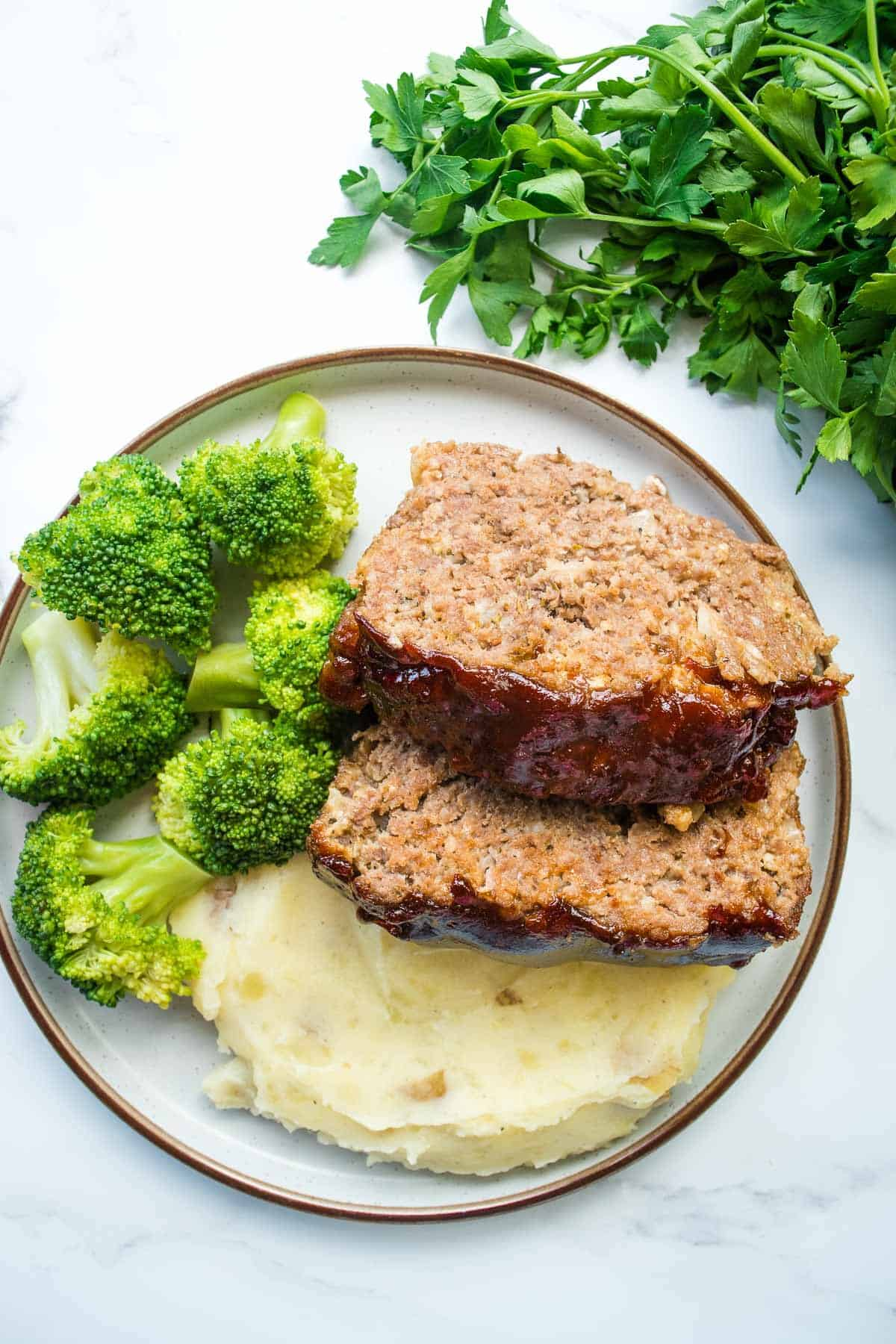 Sliced BBQ meatloaf on a plate.