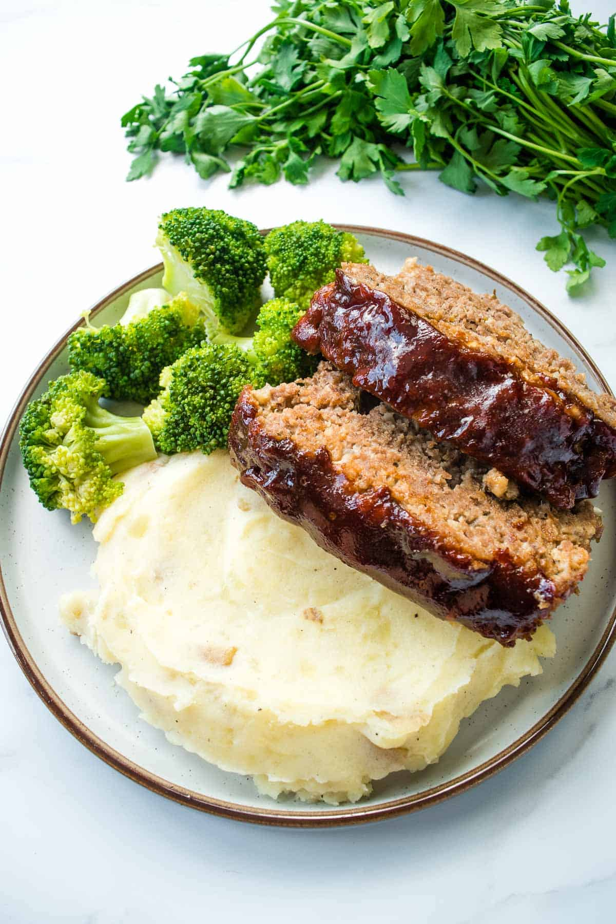 Meatloaf with broccoli and mashed potatoes.