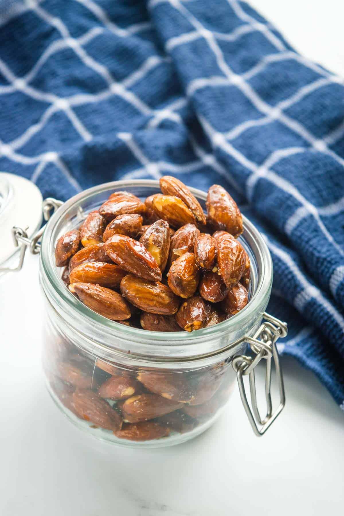 Sweet crispy roasted almonds in a mason jar.