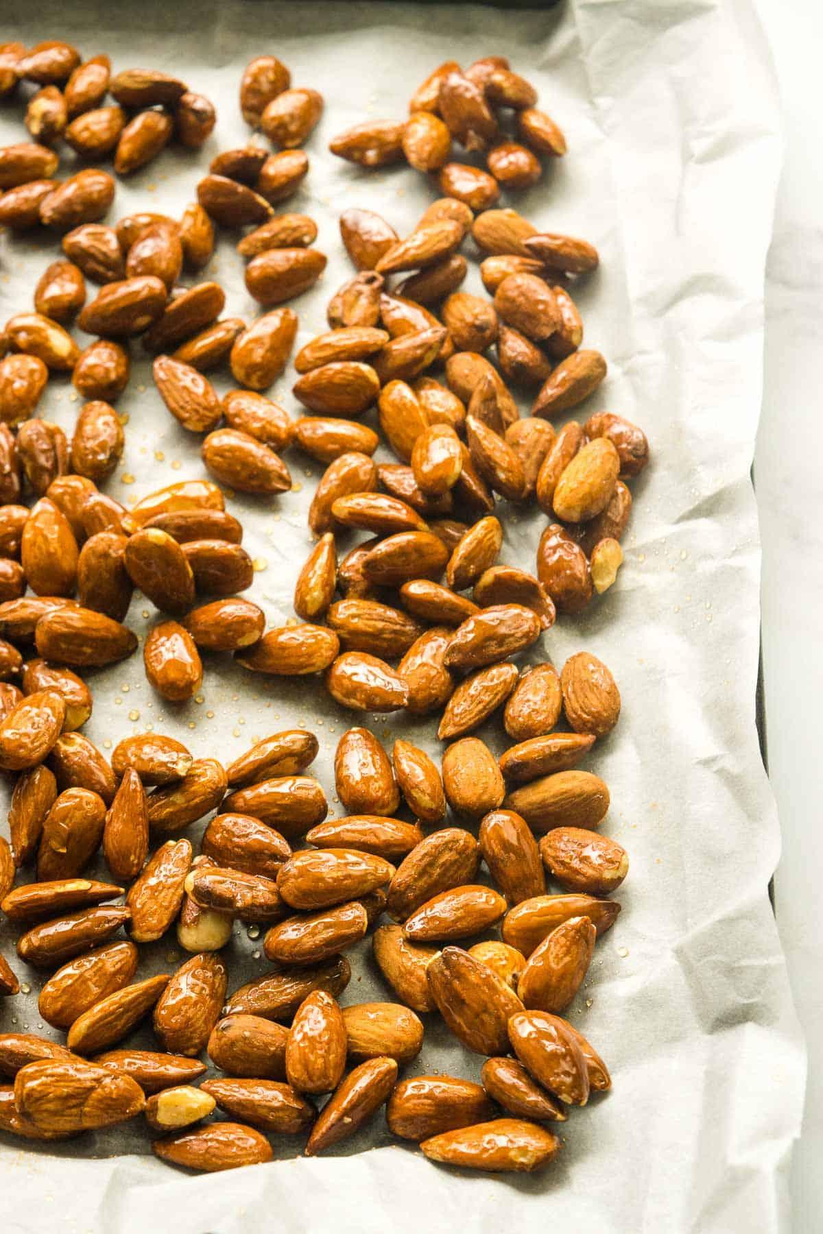 Honeyed almonds on a baking sheet.