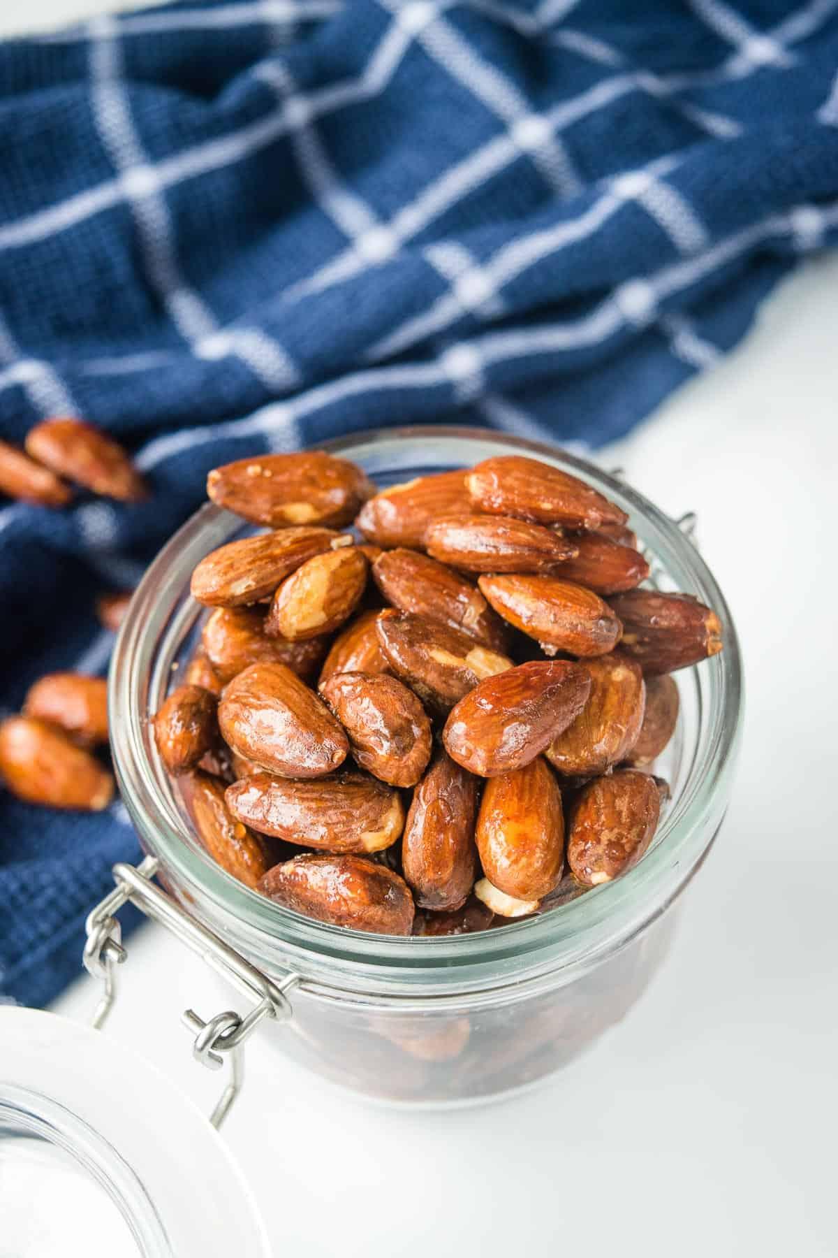 Honey roasted almonds in a jar.