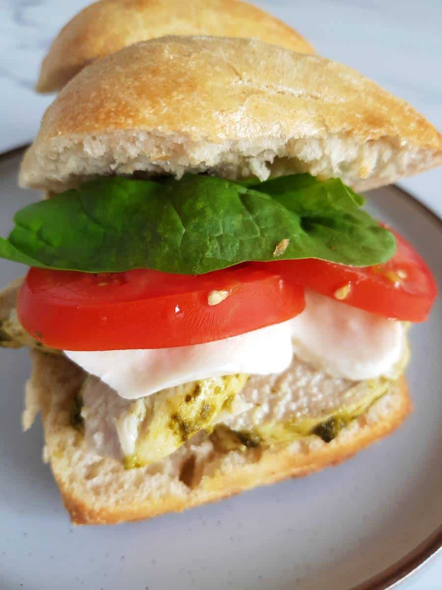 Mozzarella tomato pesto chicken sandwich.