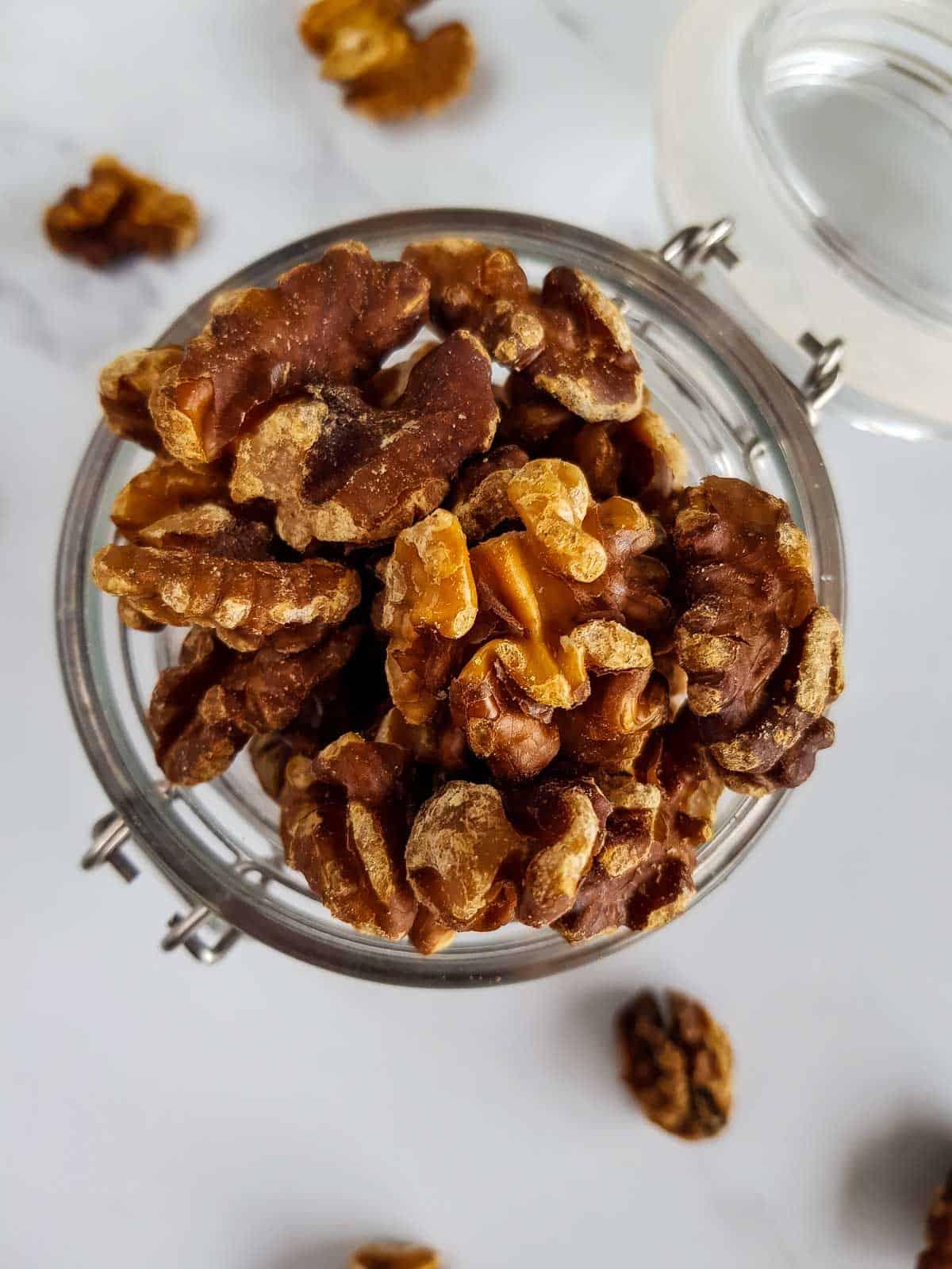 Roasted walnuts in a jar.
