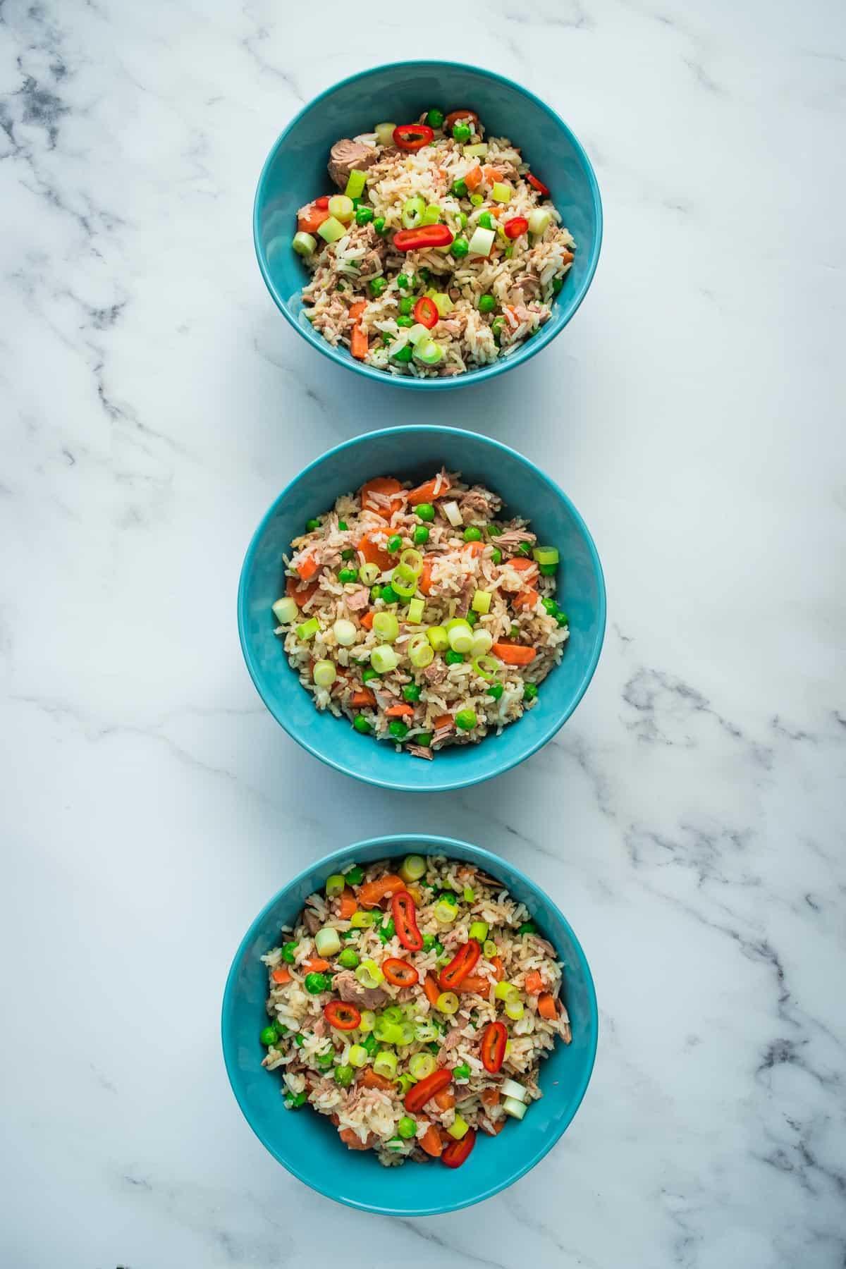 Three bowls of fried rice.