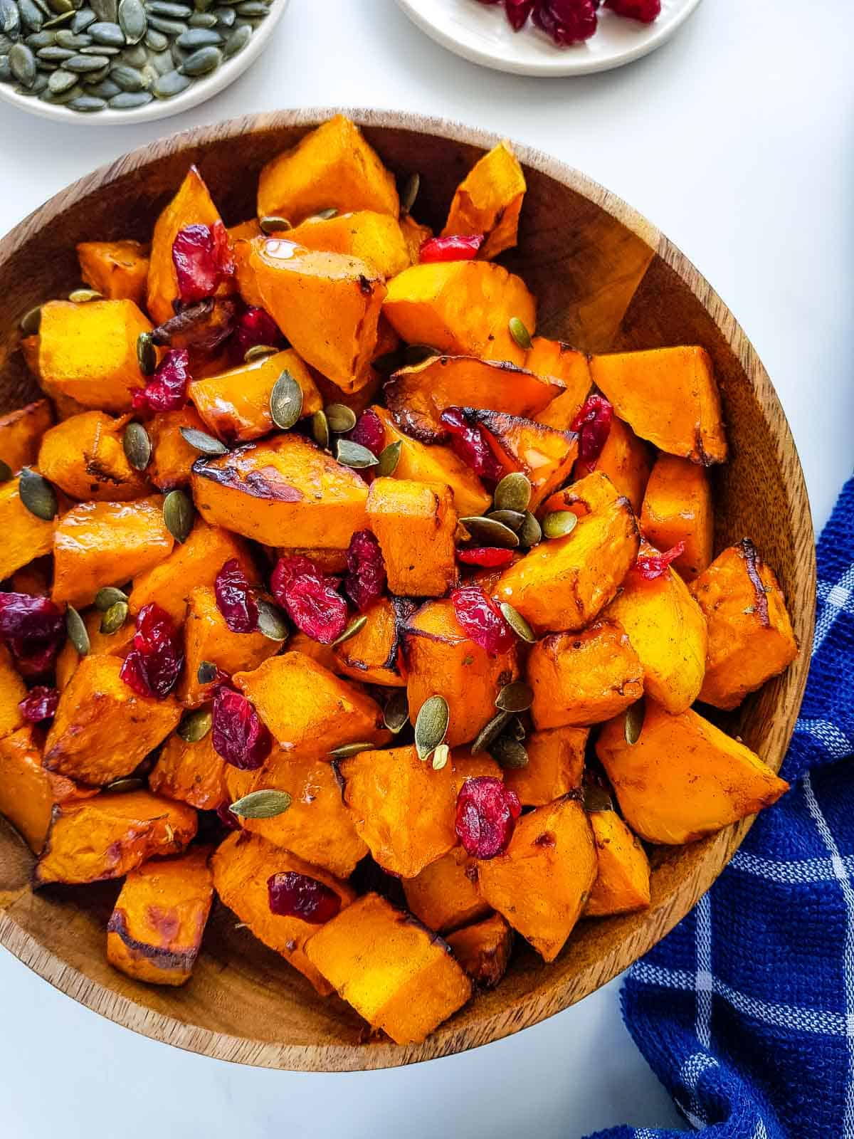 Roasted butternut squash with cranberries and pumpkin seeds.