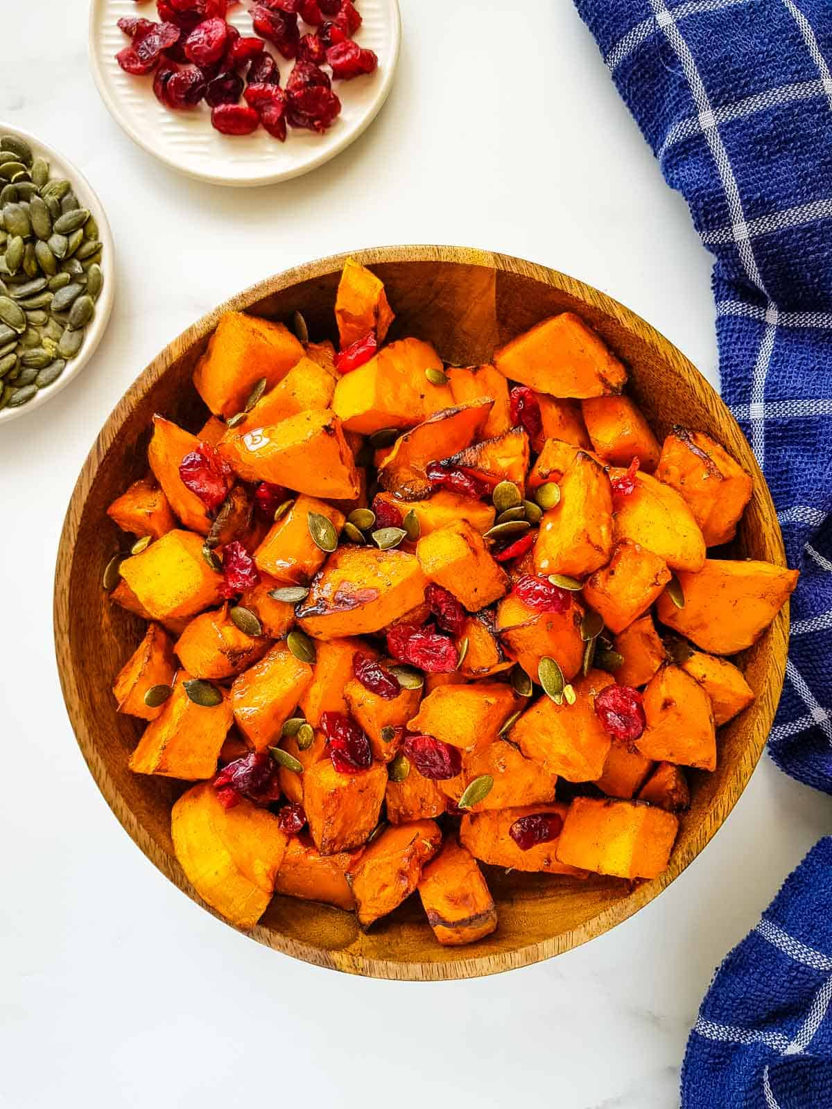 Air fryer butternut squash with pumpkin seeds and cranberries.