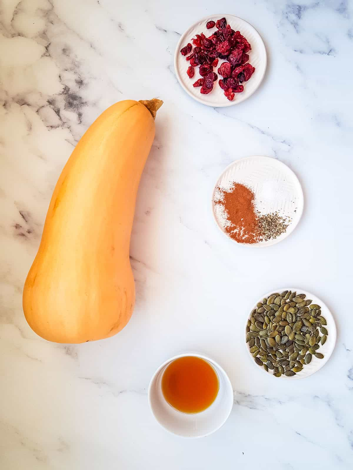 The ingredients for air fryer butternut squash laid out on a table.