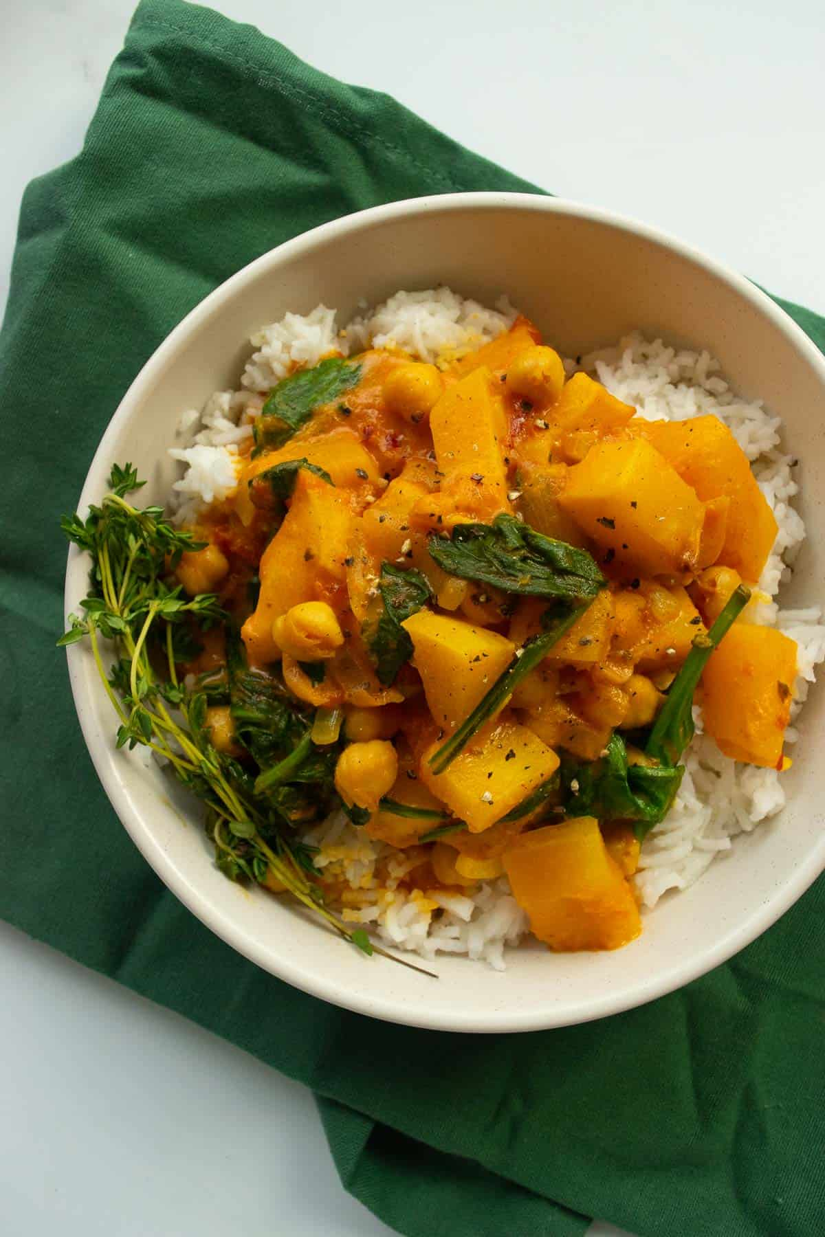 Butternut squash curry in a bowl over rice.