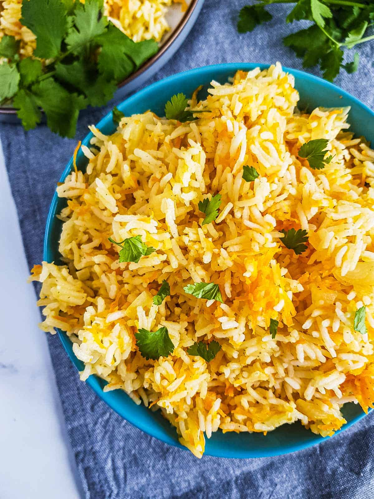 Close up of rice with grated carrots.