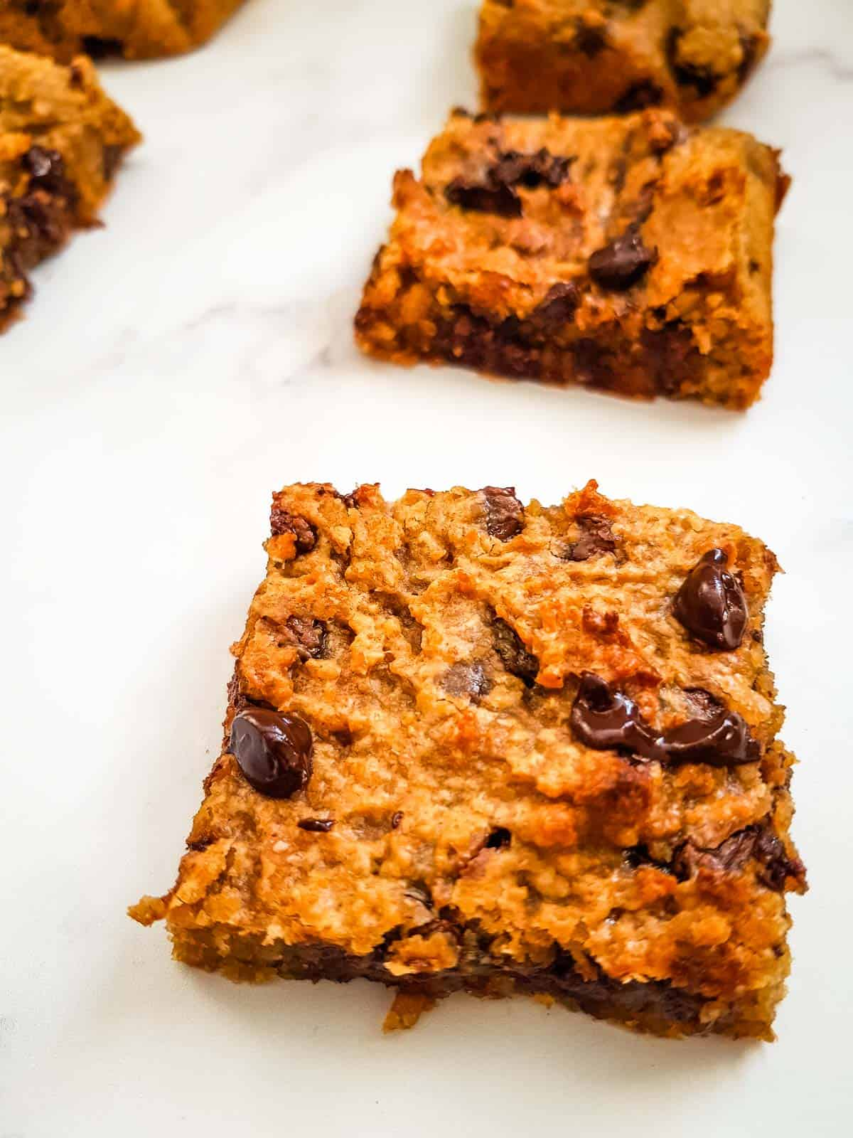 Close up of chickpea blondies with chocolate chips.