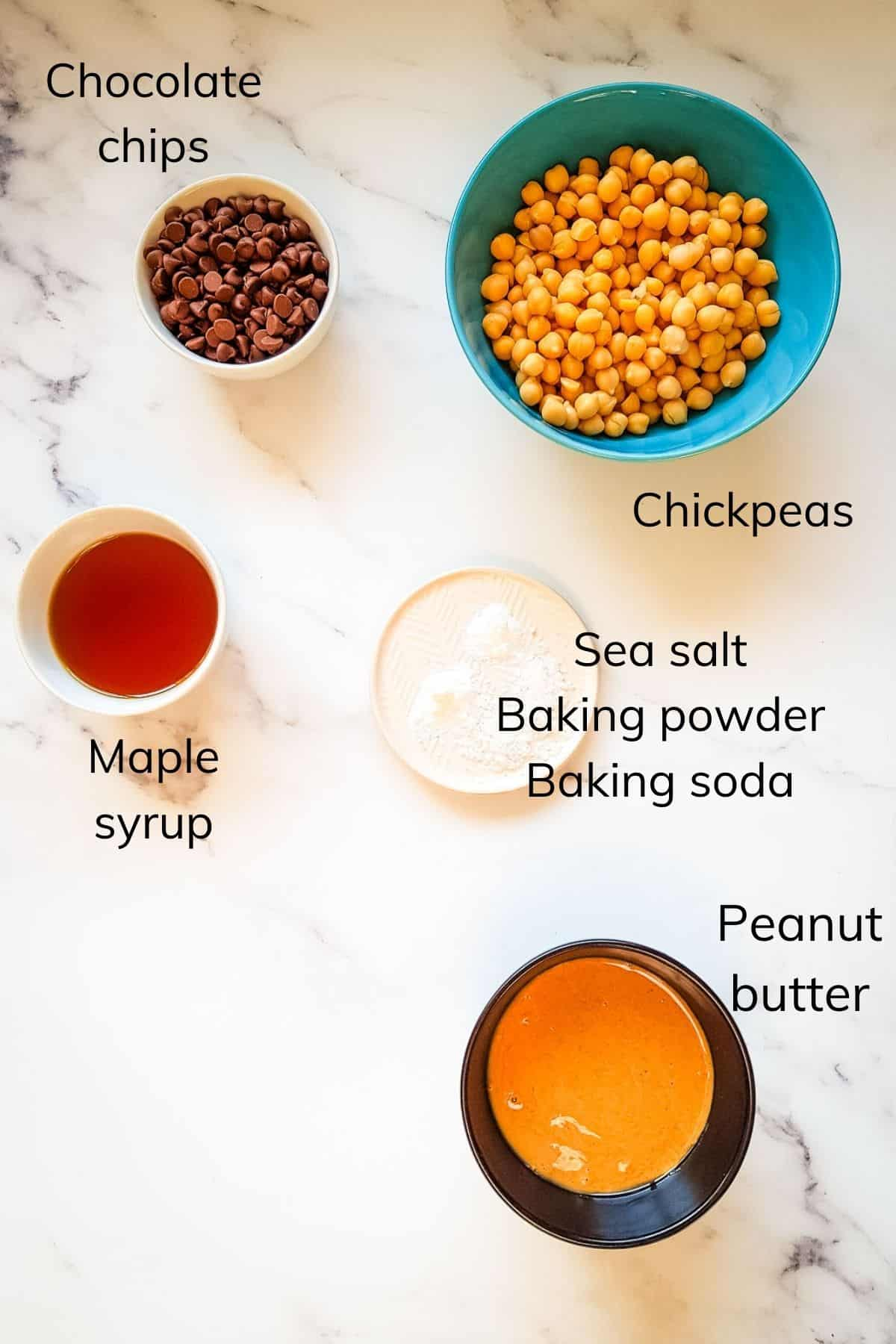The ingredients required to make chickpea blondies laid out on a table.