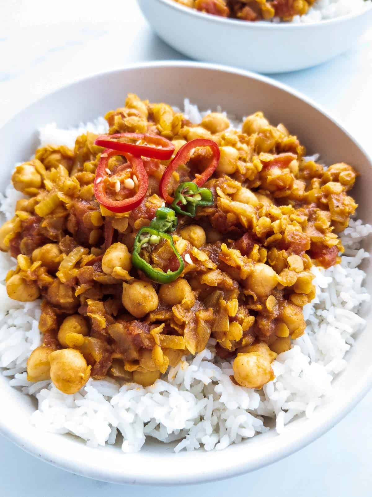 Chickpea lentil curry in a plate with rice.