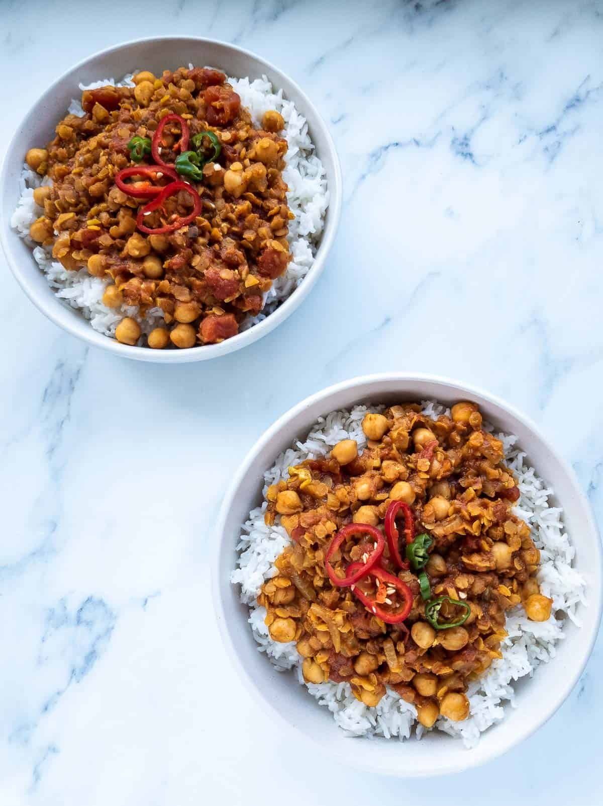 Two bowls of lentil and chickpea curry.