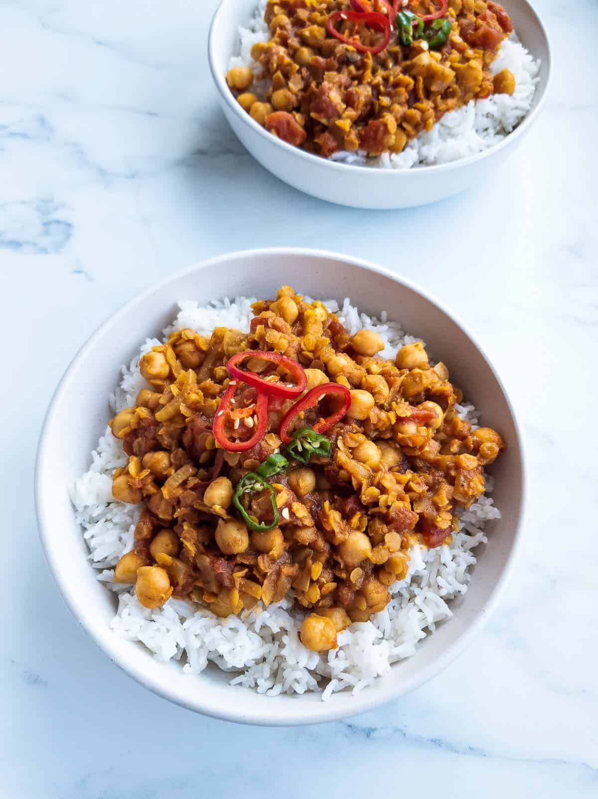 Vegan lentil curry in a bowl with rice.