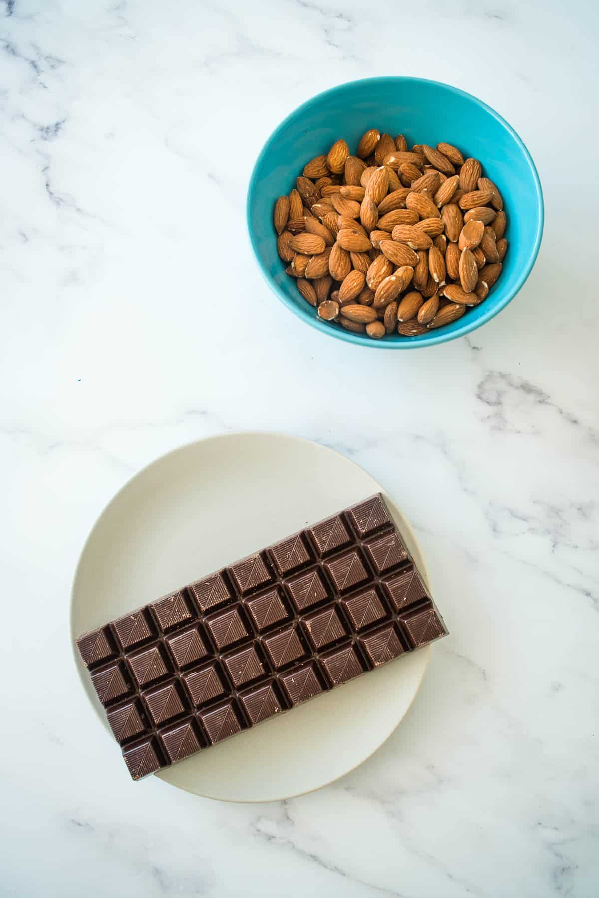 Chocolate and almonds on a table.
