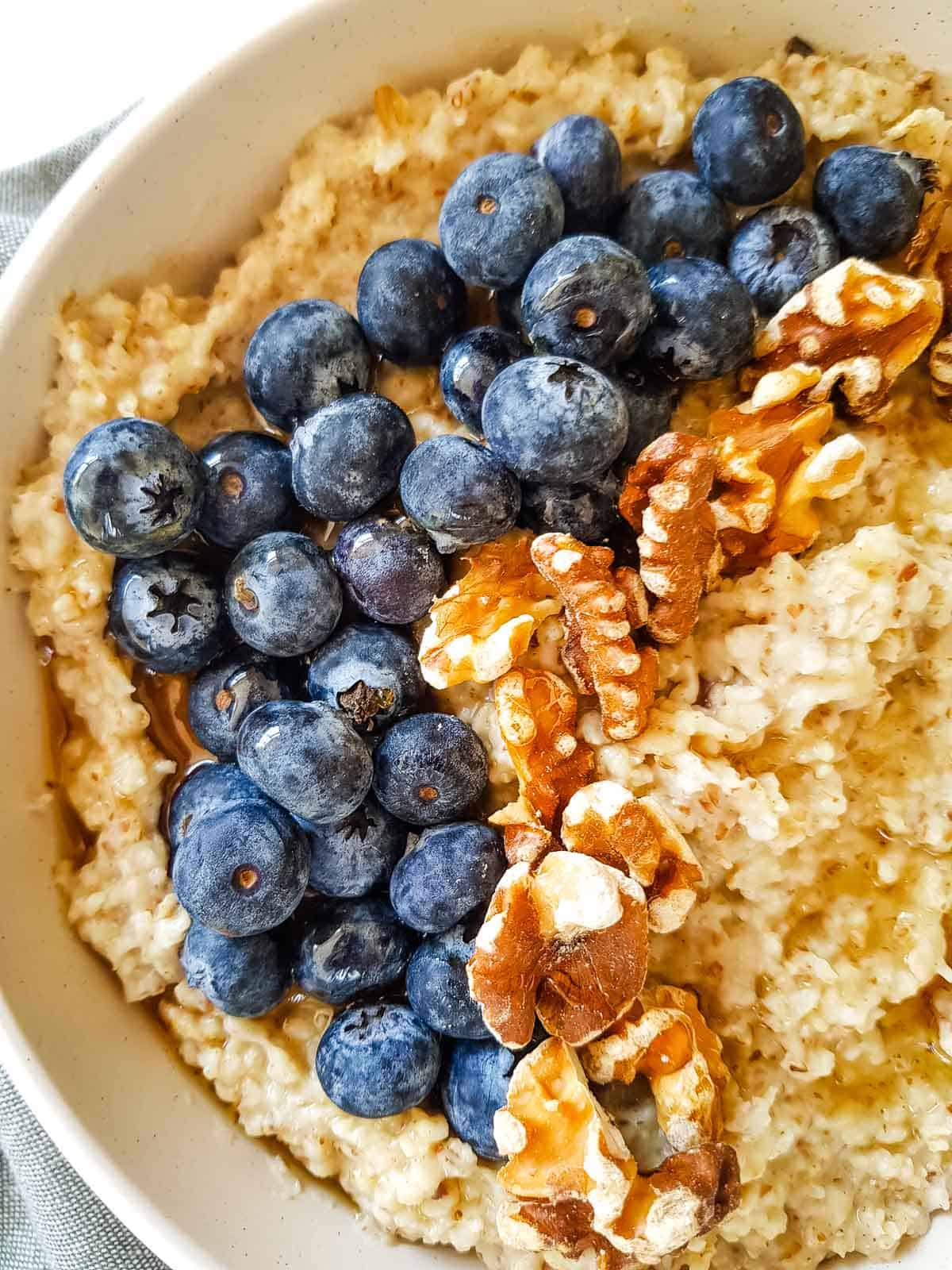 Close up of oatmeal topped with blueberries.