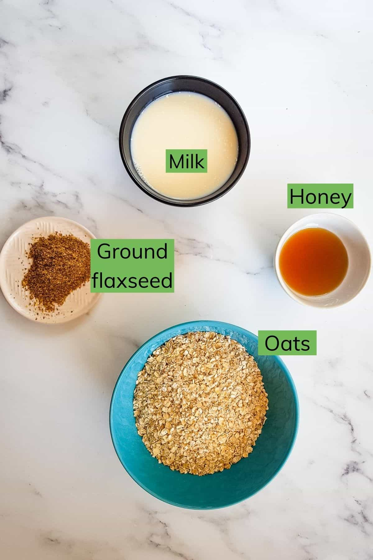 Ingredients for flaxseed oatmeal laid out on a table.