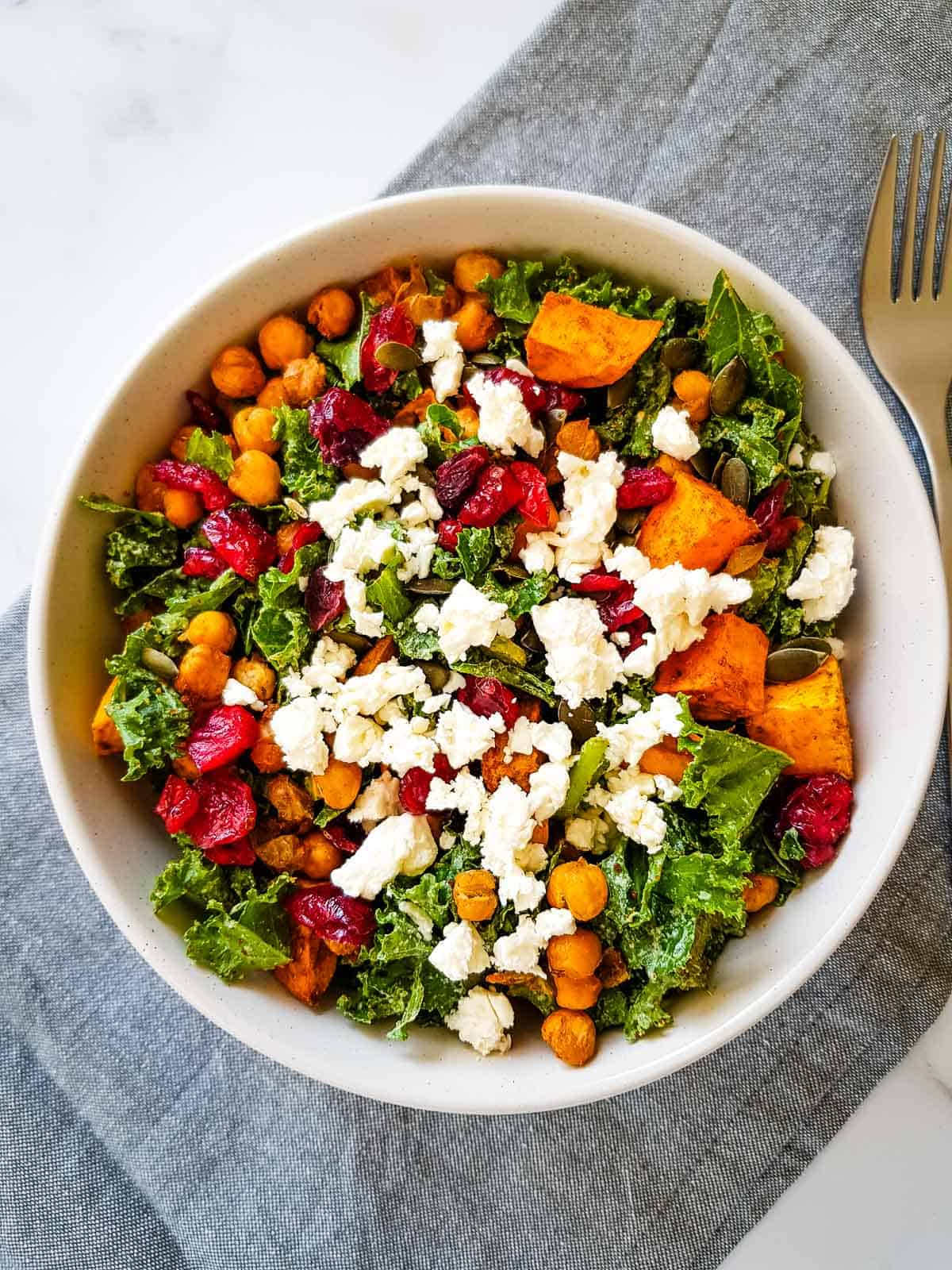 Kale and sweet potato salad with feta cheese and cranberries.