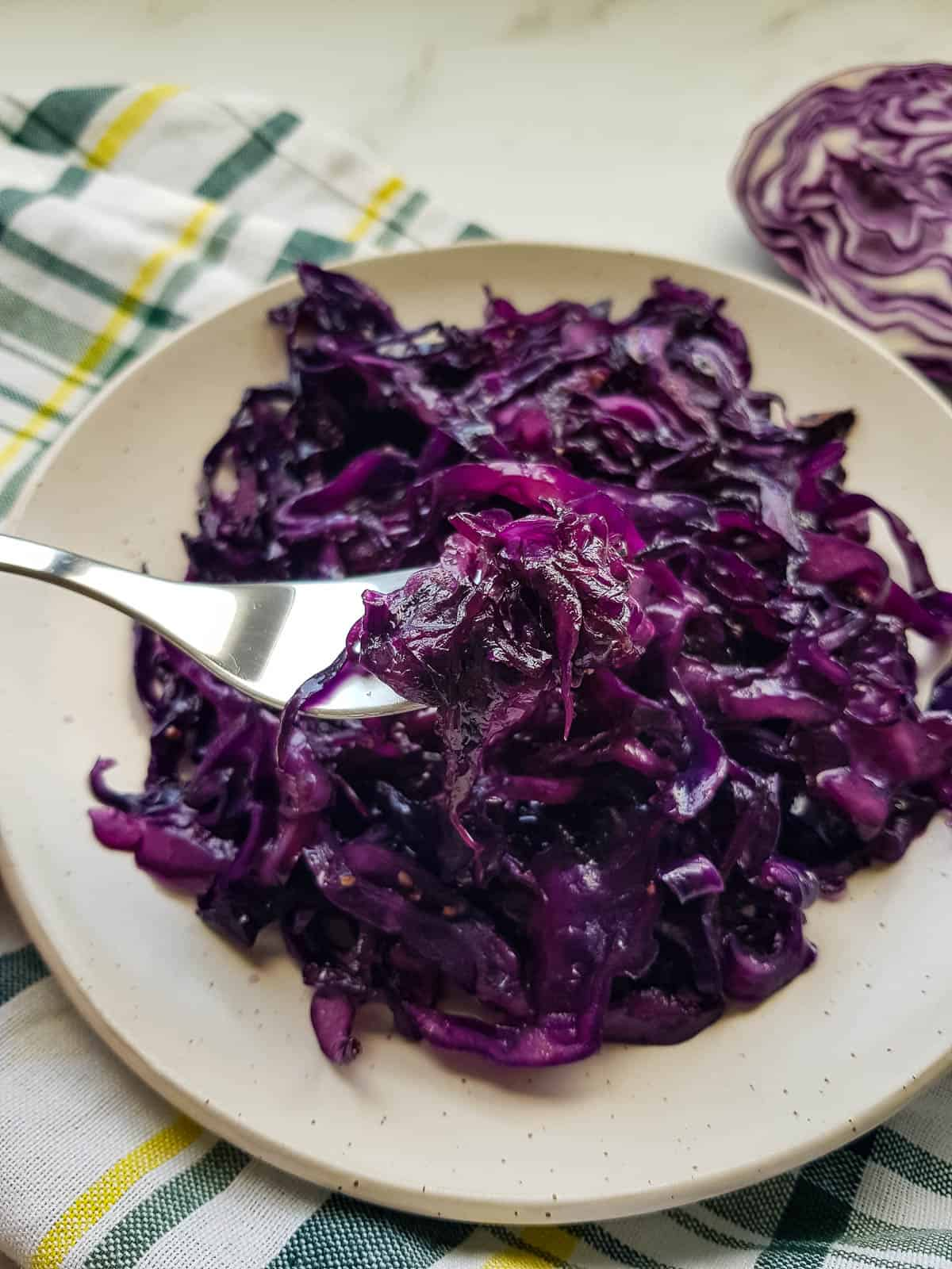Sauteed red cabbage on a plate with a fork.