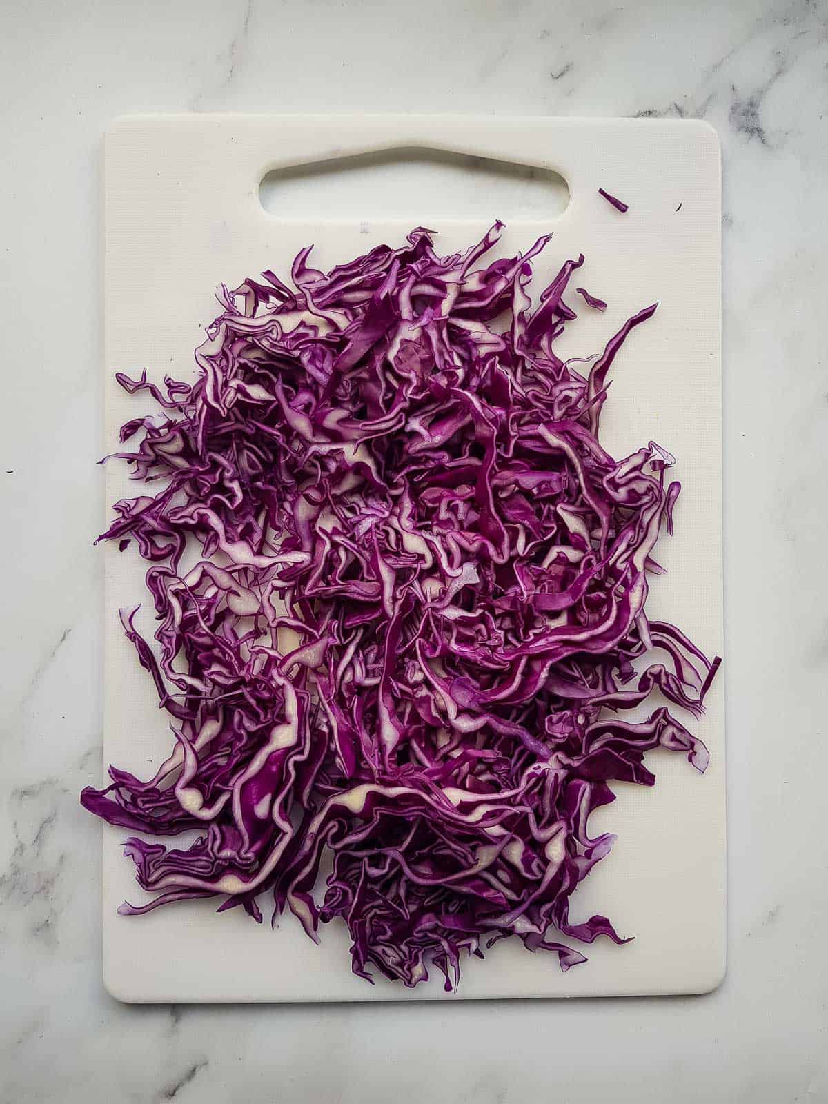 Sliced red cabbage on a chopping board.