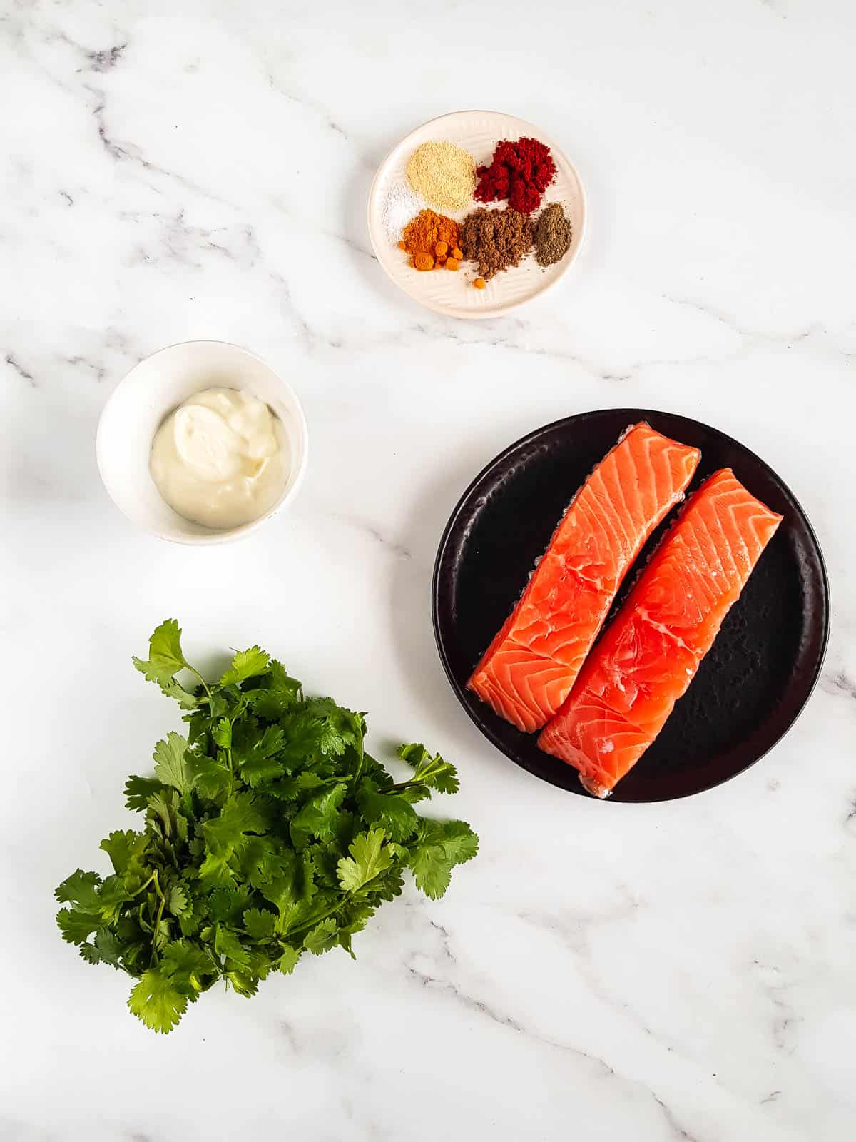 Ingredients for tandoori salmon laid out on a table.