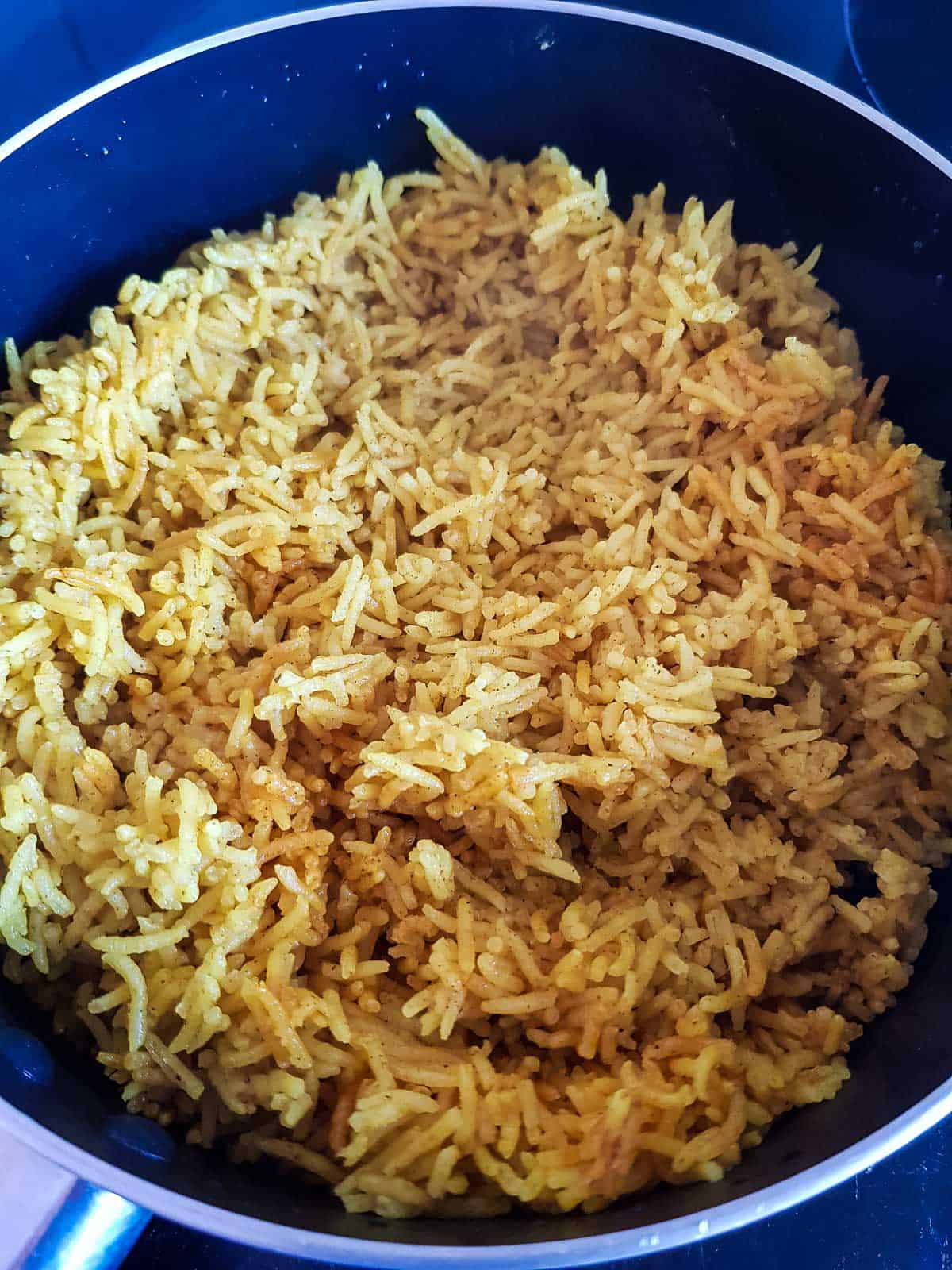 Cooked turmeric rice in a pot.