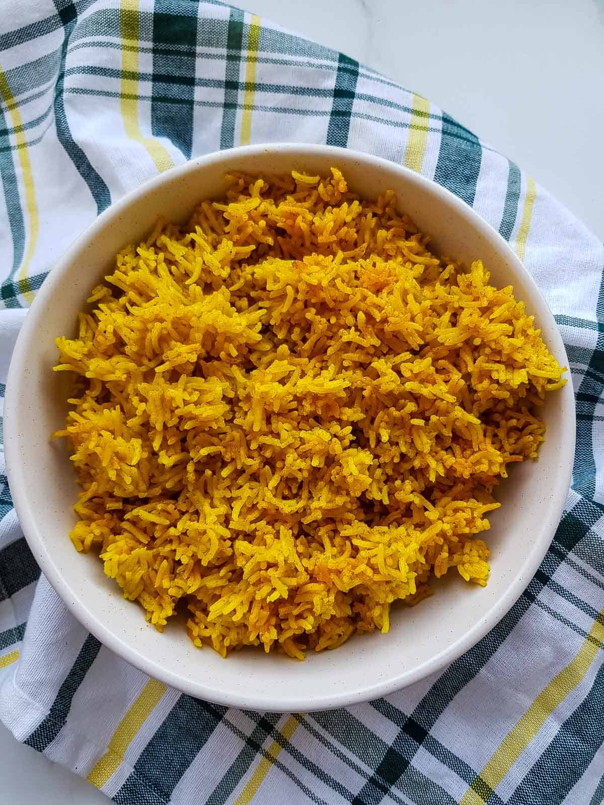 Cooked turmeric rice in a bowl.